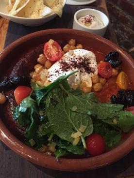 Tajine Spicy - merguez sausage, saffron tomato stew, fried pita, raita, poached egg, fresh herbs